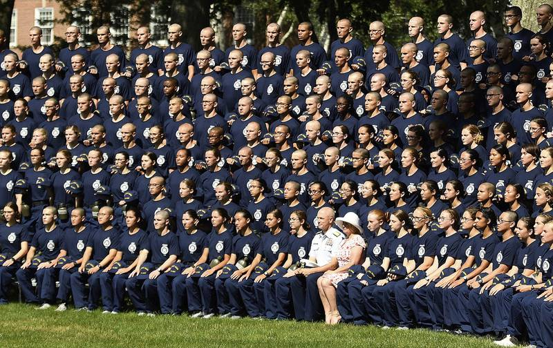 In a July 1, 2019, file photo, U.S. Coast Guard Academy Superintendent Rear Adm. William G. Kelly and his wife Angie pose with the Class of 2023 for their class photo on Day One of Swab Summer in New London, Conn