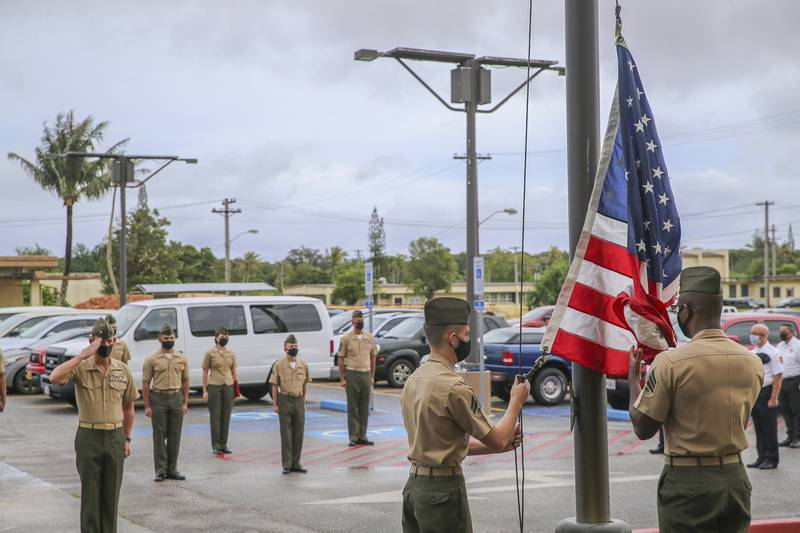 U.S. Marines assigned to Marine Corps Base (MCB) Camp Blaz conduct the first flag raising of the new command, marking the initial operation capability of the base in Dededo, Guam, Oct. 1, 2020.
