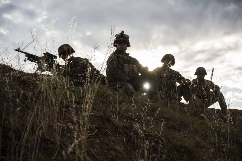 Marines with Special Purpose Marine Air-Ground Task Force-Crisis Response-Africa 19.2, Marine Forces Europe and Africa, prepare to fire their M240B machine guns during a squad attack on Campo De Maniobras, Base General Menacho, Spain