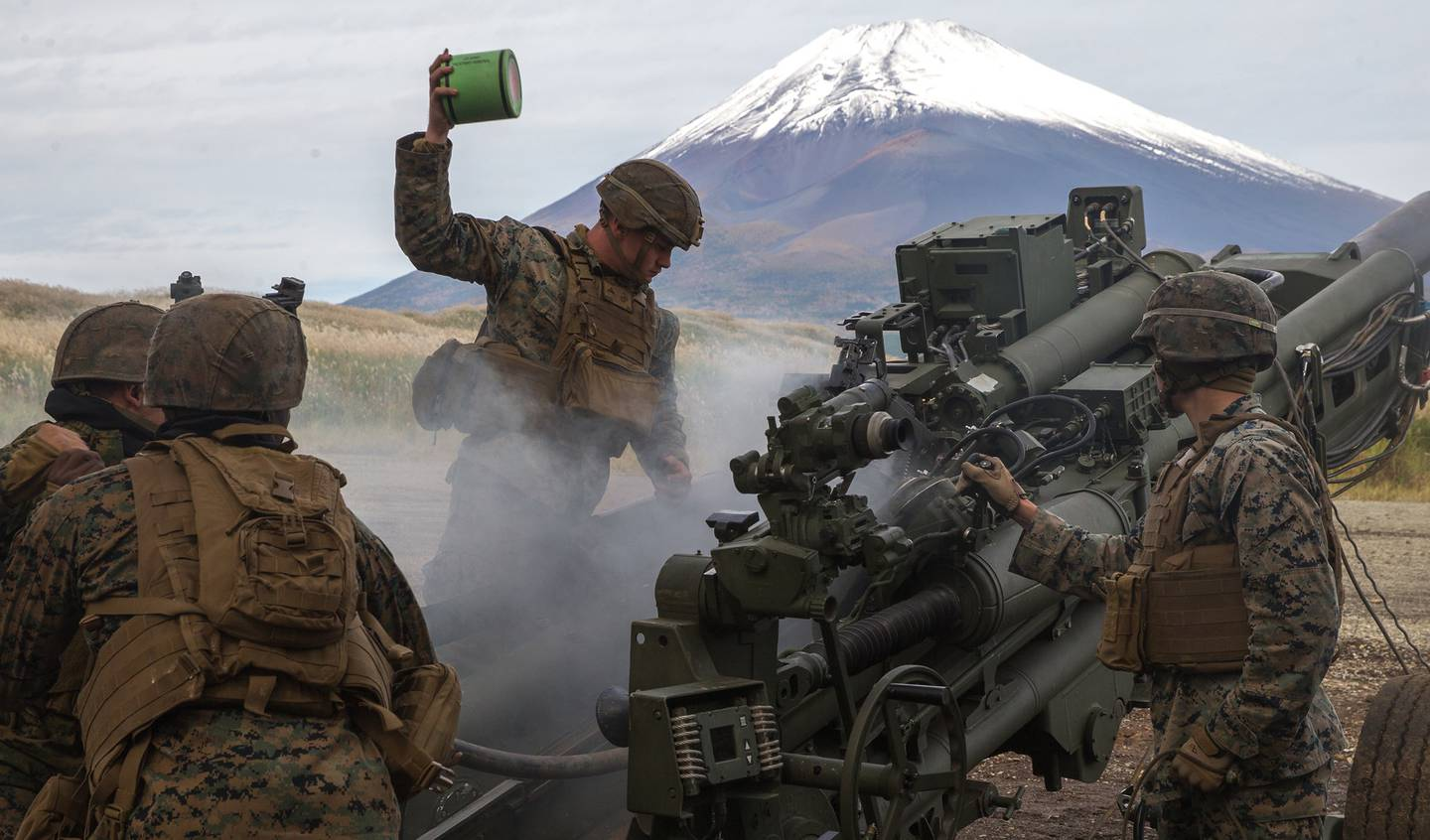 U.S. Marines prepare to fire an M777A2 155mm Howitzer as a part of the Artillery Relocation Training Program 20.3 at Combined Arms Training Center, Camp Fuji, Japan, Oct. 20, 2020.