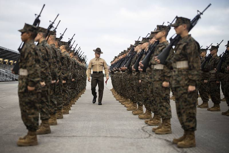 Staff Sgt. Andrew Snyder evaluates recruits with Charlie Company, 1st Recruit Training Battalion during their final drill evaluation at Marine Corps Recruit Depot, San Diego, Dec. 14, 2019.