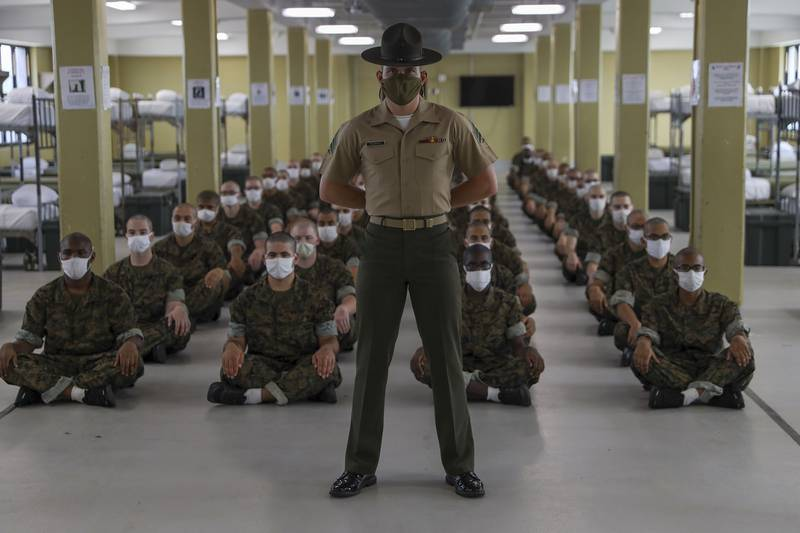 A drill instructor with Charlie Company, 1st Recruit Training Battalion, waits to report to the company commander on Marine Corps Recruit Depot Parris Island, S.C., Sept 19, 2020.
