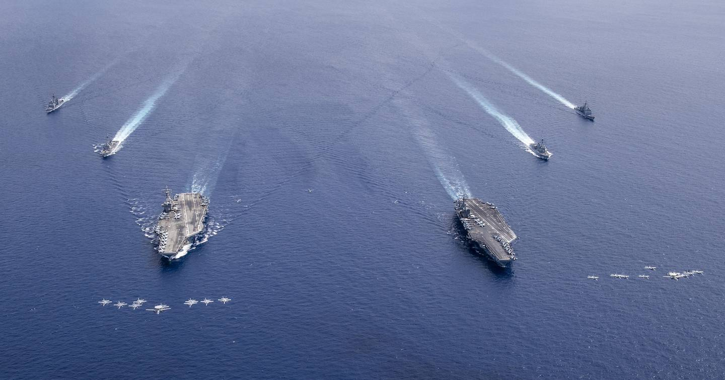 Aircraft from Carrier Air Wings (CVW) 5 and 17 fly in formation over the Nimitz Carrier Strike Force on July 6, 2020, in the South China Sea.