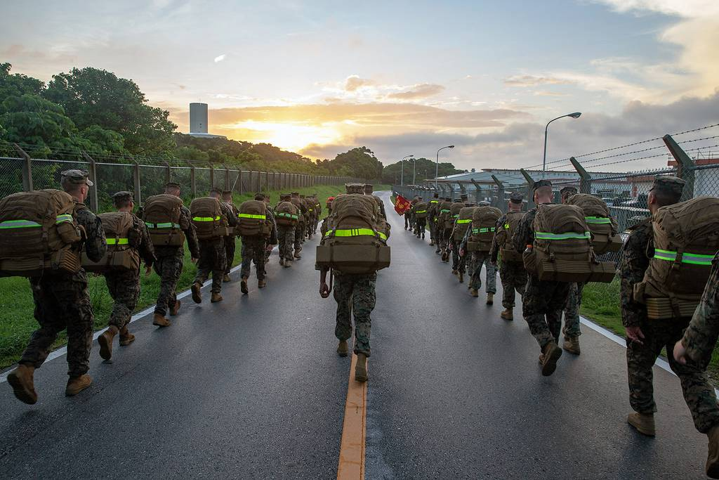 Marines participate in a 10 kilometer hike on Camp Hansen, Okinawa, Japan, July 12, 2019.
