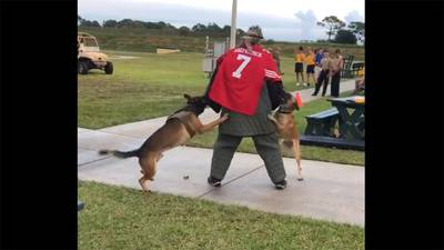 An image made from a video posted on Twitter shows a man wearing a Colin Kaepernick jersey during a K-9 demonstration at the Navy SEAL Museum in Florida.