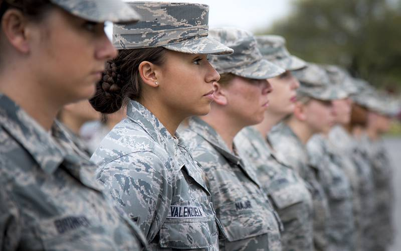 Senior Airman Heather Valenzuela, 96th Medical Group, stands at parade rest as part of an all-female formation prior to the base retreat ceremony March 30, 2017, at Eglin Air Force Base, Fla.