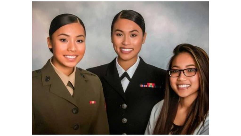 Ohu, left, in a family portrait with her older sister Pan Phyu, center, and younger sister Kay Yu.