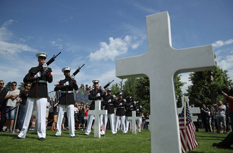 U.S. Marines fire a volley of shots while standing among the graves of U.S. service members, most of them killed in the World War I Battle of Belleau Wood, during a ceremony to mark the 100th anniversary of the battle on Memorial Day at the Aisne-Marne American Cemetery on May 26, 2018, in France.