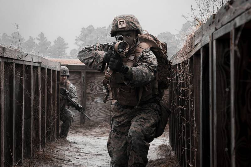A Marine with 8th Engineer Support Battalion clears a simulated enemy cache site during a simulated live-fire event during Command Post Exercise VI (CPX) on Camp Lejeune, N.C., Feb. 2, 2021.