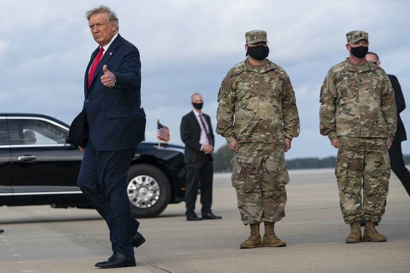 President Donald Trump gives a thumbs up after arriving at Pope Army Field for an event with troops at Fort Bragg, Thursday, Oct. 29, 2020, in Pope Field, N.C.