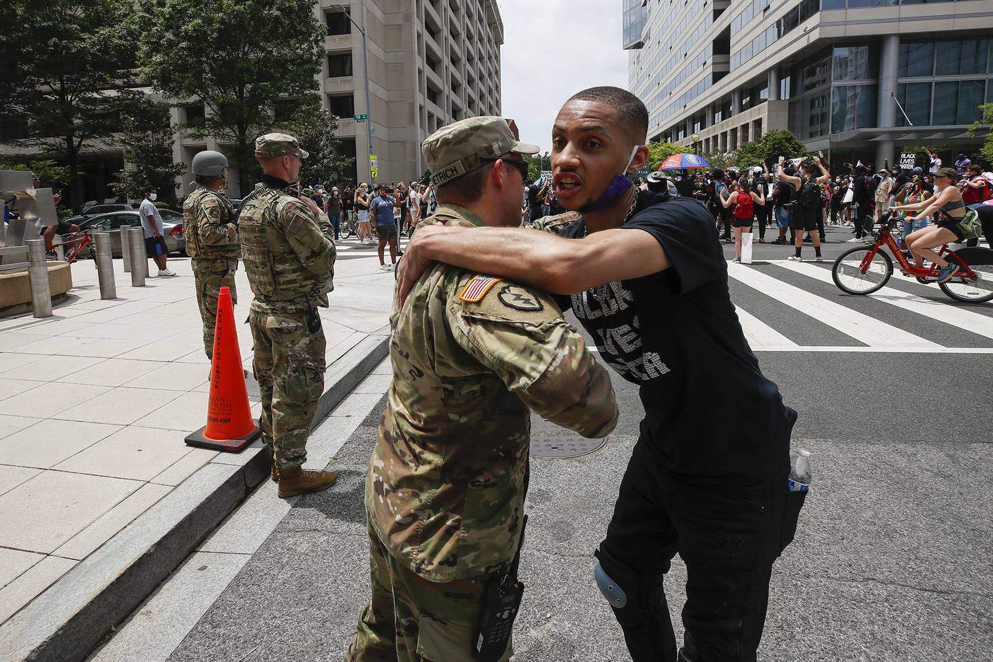 In this June 6, 2020, file photo, a demonstrator hugs a National Guard soldier during a protest  in Washington, over the death of George Floyd, a black man who was in police custody in Minneapolis.