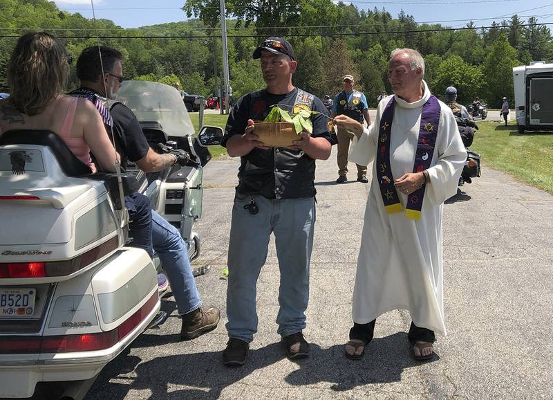 """Motorcyclists participate in a """"Blessing of the Bikes"""" ceremony in Columbia, N.H., Sunday, June 23, 2019."""