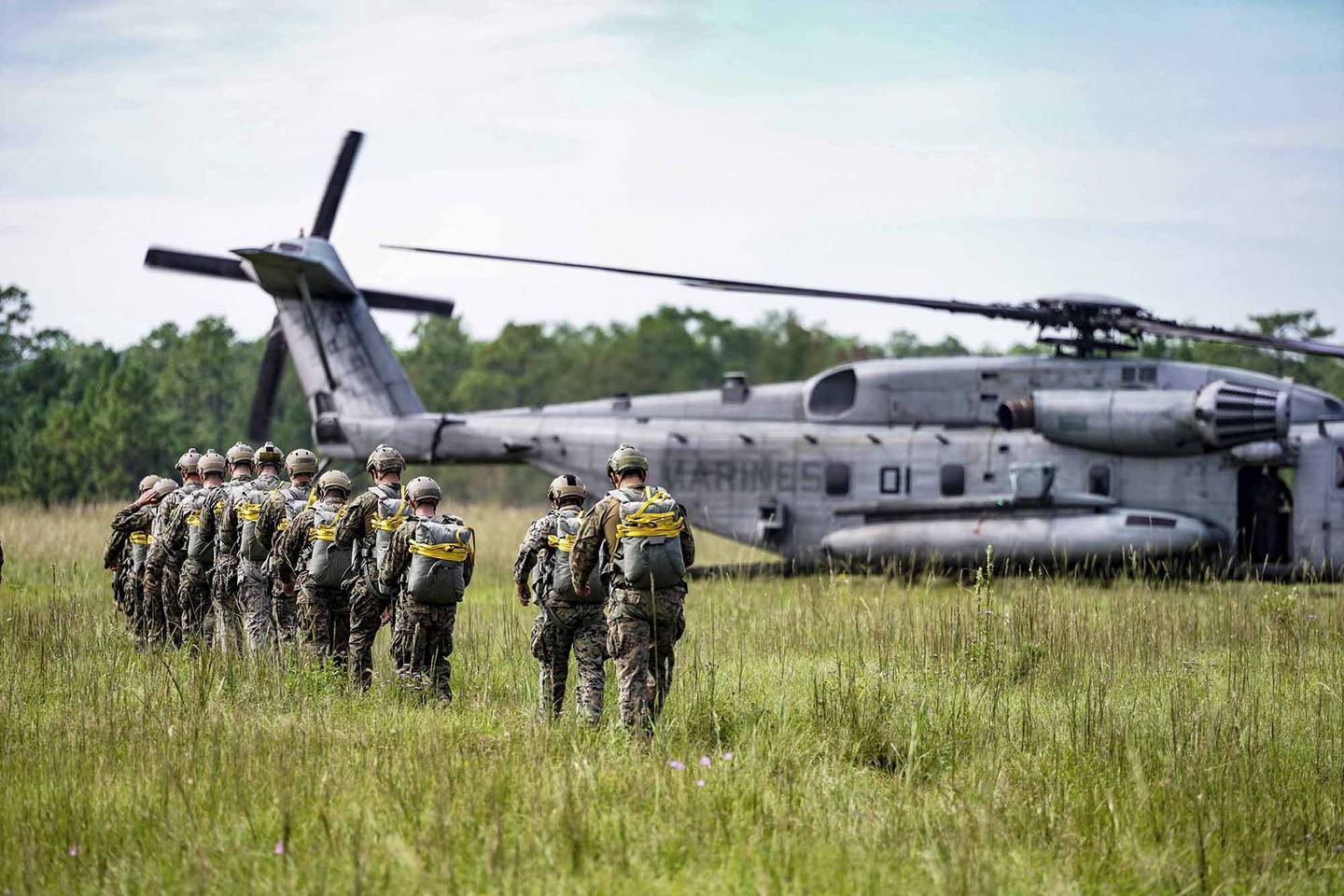 Marines with 3rd Force Reconnaissance Company, 4th Marine Division prepare to static line jump out of a CH-53 Super Stallion during an airborne operations event at Camp Shelby, Miss., Oct. 6, 2020.