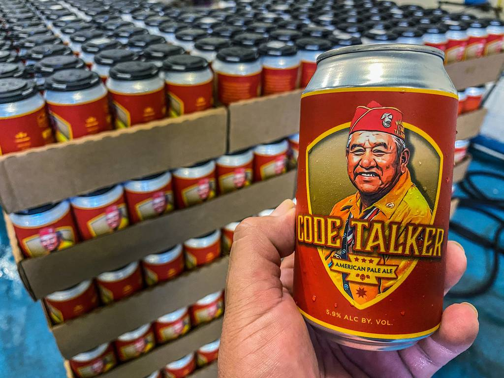 In this Aug. 14, 2020, photo LT Goodluck holds a beer can honoring his grandfather, Navajo Code Talker John V. Goodluck at the Hellbender Brewing Co., in Washington, D.C.