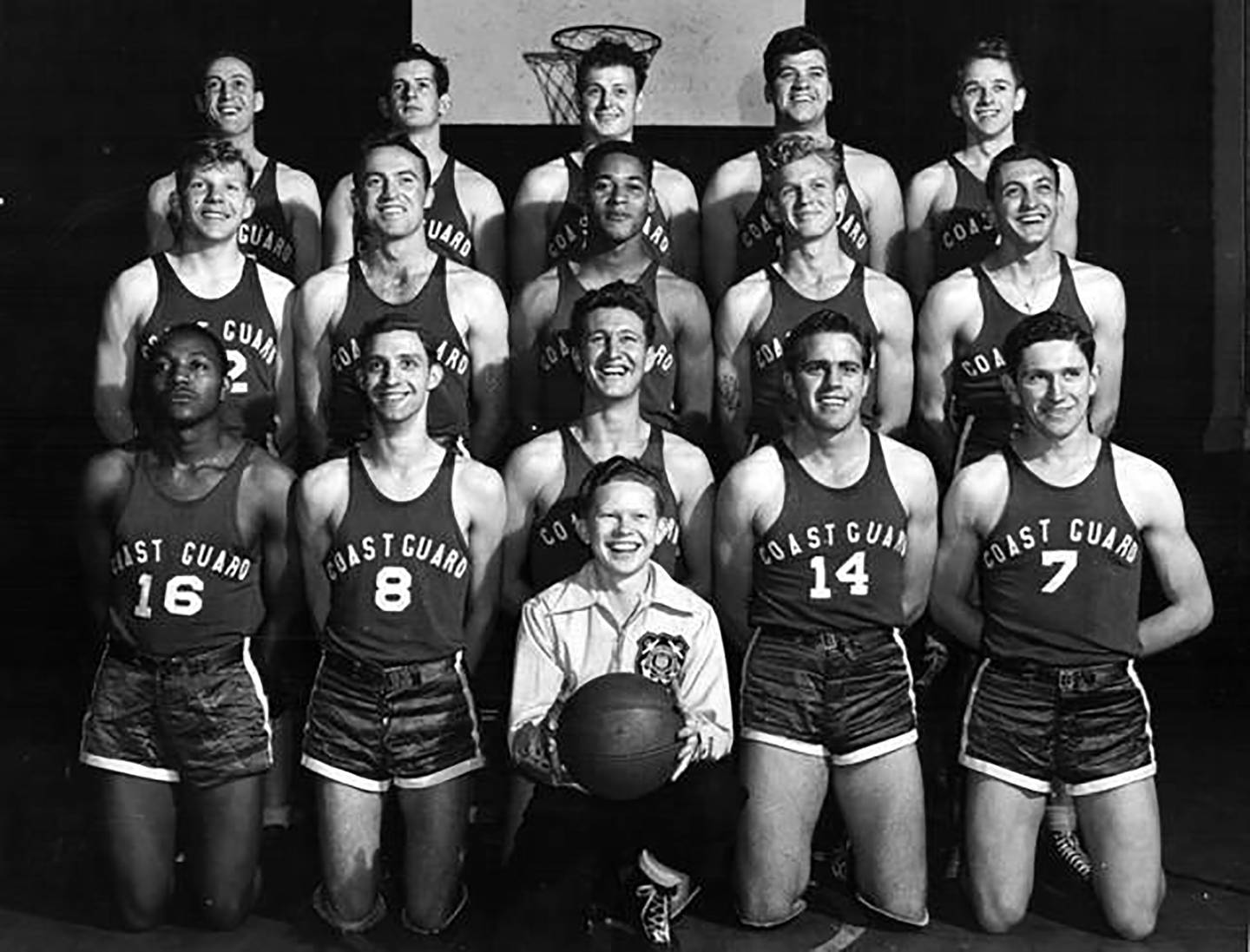 This undated photo provided by United States Coast Guard shows Emlen Tunnell, center, second from top, in a USCG basketball team photo, the first Black player inducted into the Pro Football Hall of Fame.